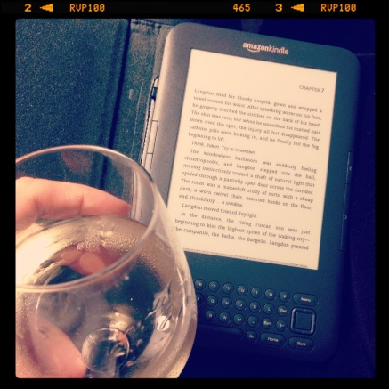 One of my favorite ways to relax: a glass of wine and a good book.